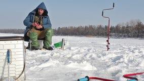 Fischer fängt einen Fisch stock video footage