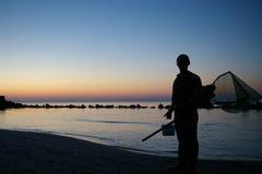 Fischer mit einem Netz Stockfotografie