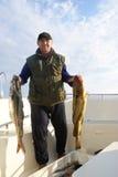 Fischer mit großen Fischen stockfotos