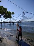 Fischer mit seinem Netz stockbilder