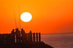 Fischer Pier Ocean Sunrise Colors lizenzfreie stockfotografie