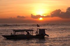 Fischer am Sonnenaufgang Stockbild