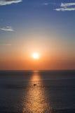 Fischerboote am Sonnenuntergangschattenbild Stockbilder