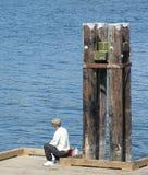 Fischerei auf dem Dock Stockfotos