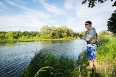Fischerei auf dem Fluss Stockbild