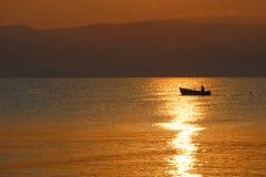 Fischerei an der Dämmerung Stockfotografie