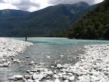Fischerei in einem Fluss Stockfoto