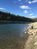 Fischerei an einem sonnigen Tag Lizenzfreie Stockbilder
