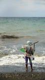 Fischerei für Sand-Krabben stockbild