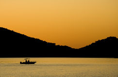 Fischerei im Sonnenuntergang Lizenzfreies Stockfoto