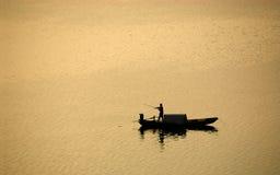 Fischerei im Sonnenuntergang Stockfotos