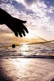 Fischerei im Sonnenuntergang Stockbild