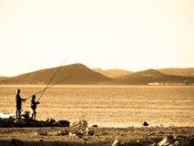 Fischerei mit zwei Männern Lizenzfreies Stockbild