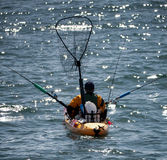 Fischerei von einem Kajak Lizenzfreie Stockbilder