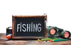 Fischereiausrüstung und Tafel Stockbilder