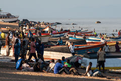 Fischermen relax at the beach of Lake Malawi. Stock Images