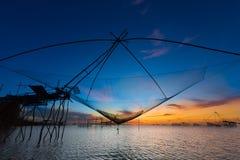 Fischernetz mit schönem Sonnenaufgang Lizenzfreies Stockbild