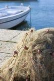 Fischernetz und Boot Stockfoto