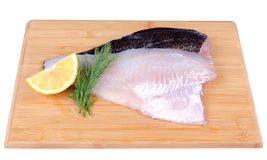 Fischfilets auf einem Vorstand Stockfoto