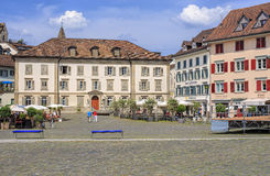 Fischmarktplatz square in Rapperswil, Switzerland. Rapperswil, Switzerland - 12 June, 2015: view on Fischmarktplatz square from the Seequai quay. City of stock images