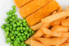 Fischst?bchen-Chips und Erbsen lizenzfreies stockfoto