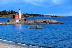 Fisgard Lighthouse along the coast near Victoria, BC. Fisgard Lighthouse National Historic Site along the Pacific coast near Victoria, BC, Canada Stock Photo