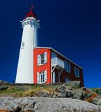 Fisgard Lighthouse, Fort Rodd Hill National Historic Site, Vancouver Island, Canada. Historic Fishgard Lighthouse sits atop a small rocky outcropping at the Stock Image