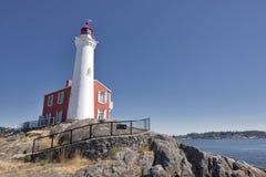 Fisgard Lighthouse. Historic Fisgard Lighthouse guarding Esquimalt Harbour near Victoria on Vancouver Island Royalty Free Stock Photography