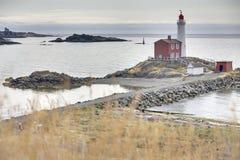 Fisgard Lighthouse Historical Site, Victoria, BC. Historic Fisgard Lighthouse located near Victoria, British Columbia overlooking the Strait of Juan de Fuca Stock Images