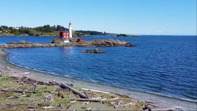 Fisgard Lighthouse with waves along the Pacific coast near Victoria, BC, Canada stock footage