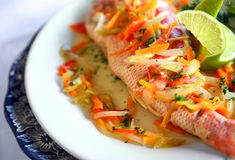 Fish. Plate of marinate fish with vegetables and lemon Stock Photo