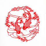 Fish. This is a picture of Chinese paper cutting. paper-cut is one of the traditional Chinese arts and crafts Stock Photo