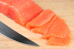Fish. Salty sliced on a chopping board and a knife Royalty Free Stock Photography