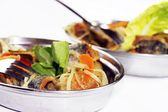 Fish. Greek-style fish with vegetables dish Royalty Free Stock Photo