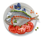Fish. Plate with fish, tomatoes, peas and caviar on a white background Royalty Free Stock Image