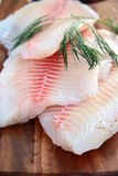 Fish. Three raw fish steaks on a wooden board royalty free stock photography