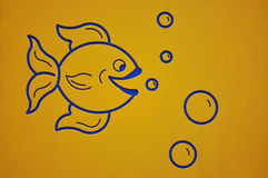 Fish. A photo taken on a wall painting of a fish blowing bubbles Royalty Free Stock Image