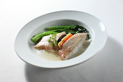 Fish. Steamed fish with vegetables at the side with some soup stock photo