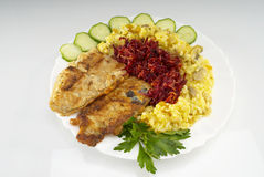 Fish. Fried fish fillet with rice and beet garnish Stock Photo