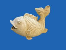 A fish. Yellow stone fish on dark-blue background stock image