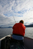 Fish Alaska. A woman casts a fishing line in Alaska royalty free stock photos