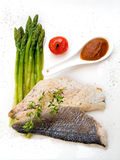 Fish with asparagus Stock Image