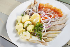Fish assortment with boiled potatoes Royalty Free Stock Image