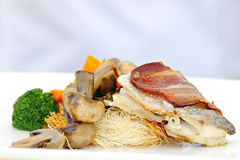 Fish bacon and vegetables Royalty Free Stock Photos