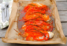 Fish baked with bell pepper and carrot. Fish fillet baked with bell pepper and carrot Royalty Free Stock Photo