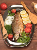 Fish baked in foil on a tray Stock Image