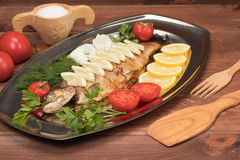 Fish baked in foil on a tray Stock Photo