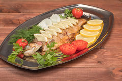 Fish baked in foil on a tray Stock Images