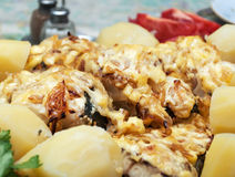 Fish baked with onions. And boiled potatoes Stock Image