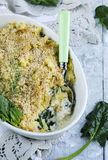 Fish baked with potatoes and spinach.  fish pie. Royalty Free Stock Image